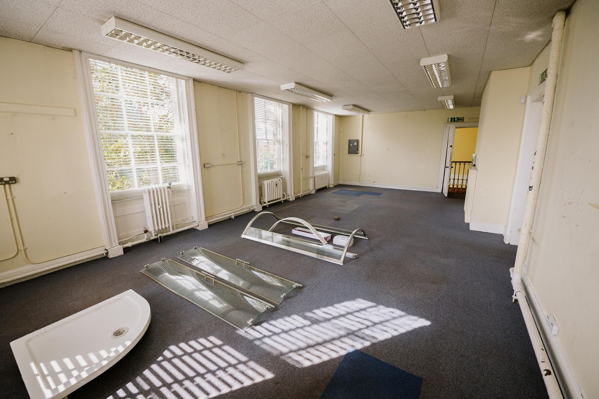 Some of the rooms are currently tired offices. Glyn plans to renovate them