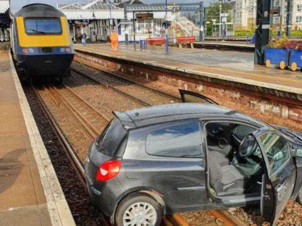 Car on rail tracks