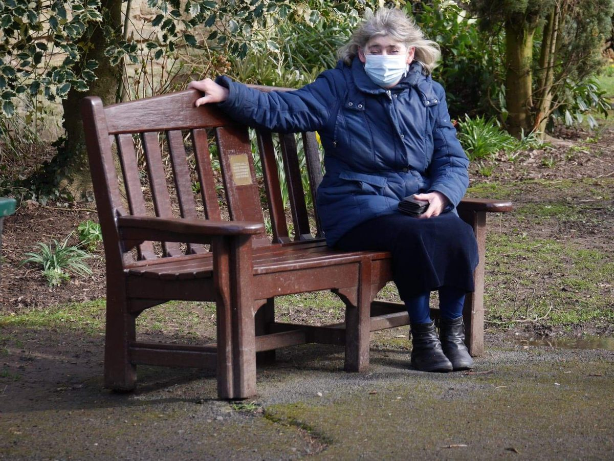 Jean Parker sat on one of the restored benches