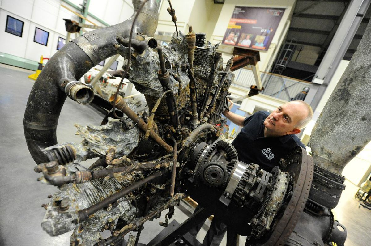 Aircraft technician John Warburton at work on the outside of the Dornier
