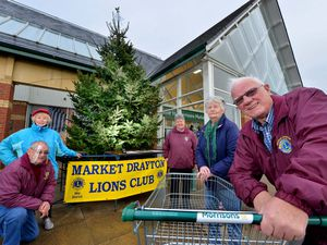 Members of the Market Drayton Lions Club promoting their Tree of Light Appeal at Morrisons, Market Drayton, last year