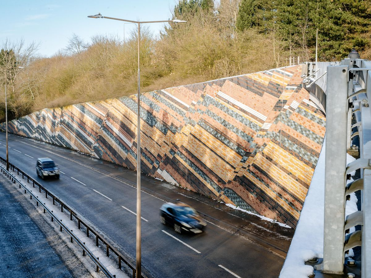 The recognisable wall along the A442
