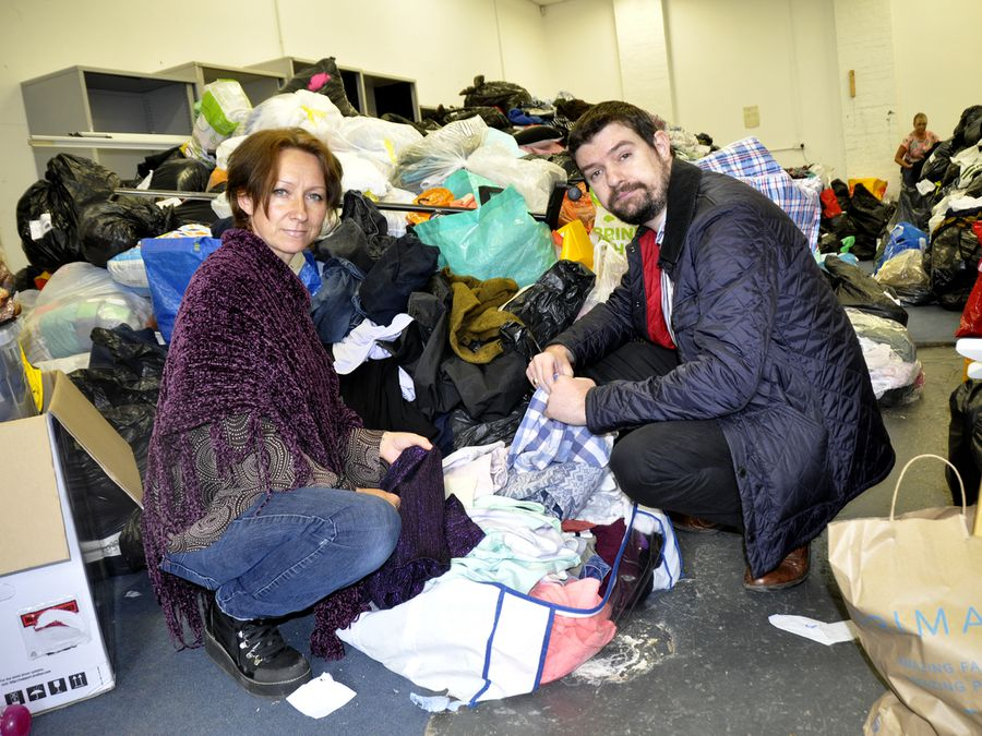 Amanda Jones and Councillor Dean Carroll at the new storage unit, with just some of the donations