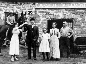 """nostalgia pic. Cockshutt. Unidentified group outside 'Cockshutt Implements'. Date unknown. Around 1910? Picture from postcard collector Ray Farlow. FTER PUBLICATION ON DECEMBER 5, 2020, HAD FOLLOWING FEEDBACK Wendy Jones 01939 270285 Mmm, thought Mrs Wendy Jones when she saw this photo of folk outside """"Cockshutt Implements"""" in our Pictures From The Archive slot. We had ventured that it was taken at Cockshutt, near Ellesmere. But Mrs Jones has got in touch to say: """"I don't think it is the Ellesmere Cockshutt. I did a history of Cockshutt Remembered and certainly didn't come across that. """"My theory is that it is the Cockshutt in Telford. I just saw the picture and though 'no, that's not our Cockshutt'. I live in Cockshutt. So it must be the other one."""" There is indeed a Cockshutt in the general Oakengates area of Telford. To that we can throw into the mix that there was a Canadian firm called Cockshutt Implements, but it doesn't seem to have been going before the 1930s and the photo we published seems at least 10 years or more before then.Library code: Cockshutt nostalgia 2004a.Library code: Cockshutt nostalgia 2004a."""
