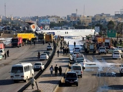 Plane skids off runway and into street in Iran