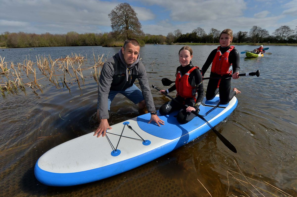 Mark Harnden, from Get Outside The Classroom at Alderford Lake, with Annabel Jones, 12, and Mia Hancock 13