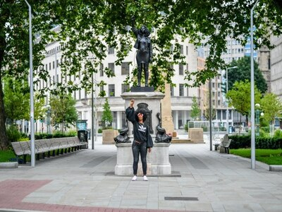 Sculpture of black protester installed on plinth on Edward Colston statue