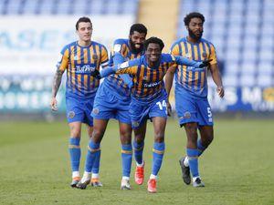 Nathanael Ogbeta of Shrewsbury Town celebrates after scoring a goal to make it 3-0. (AMA)