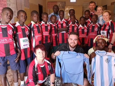 Champion gift from pupils for overseas footballers