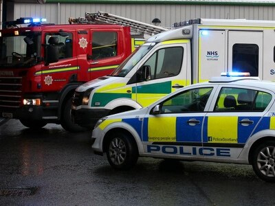 Fire crews working to remove pair from three-car crash involving police vehicle