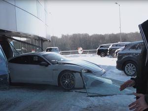 Porsche Taycan crashes through dealership window