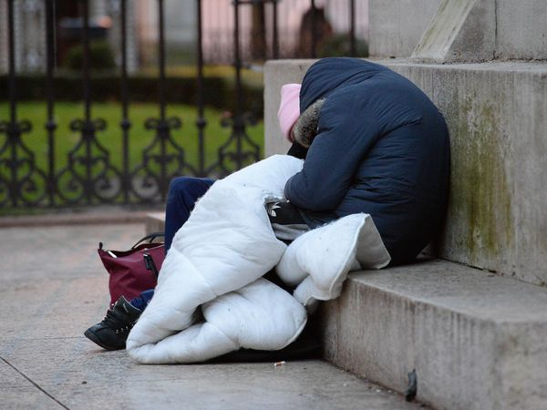 Homeless people sleep on the plinth of the Ferdinand Foch equestrian statue in Victoria, London