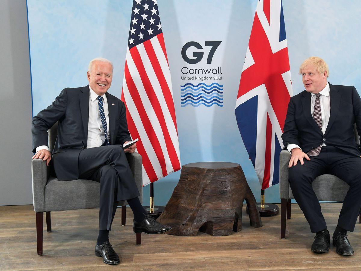 US President Joe Biden talks with Prime Minister Boris Johnson