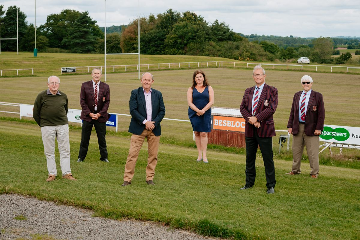 Rugby club management and agricultural society trustees toast the news