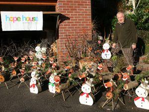 Steve Wilson with his snowmen and reindeer
