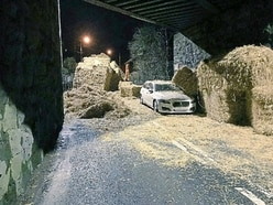 Car buried by hay as lorry crash shuts road
