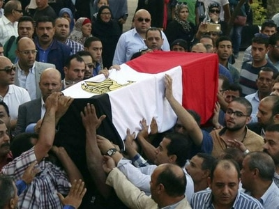 Egypt's president vows to quash terrorism after police massacred in ambush