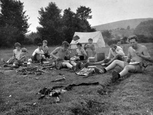 A meal around the camp fire in 1959.