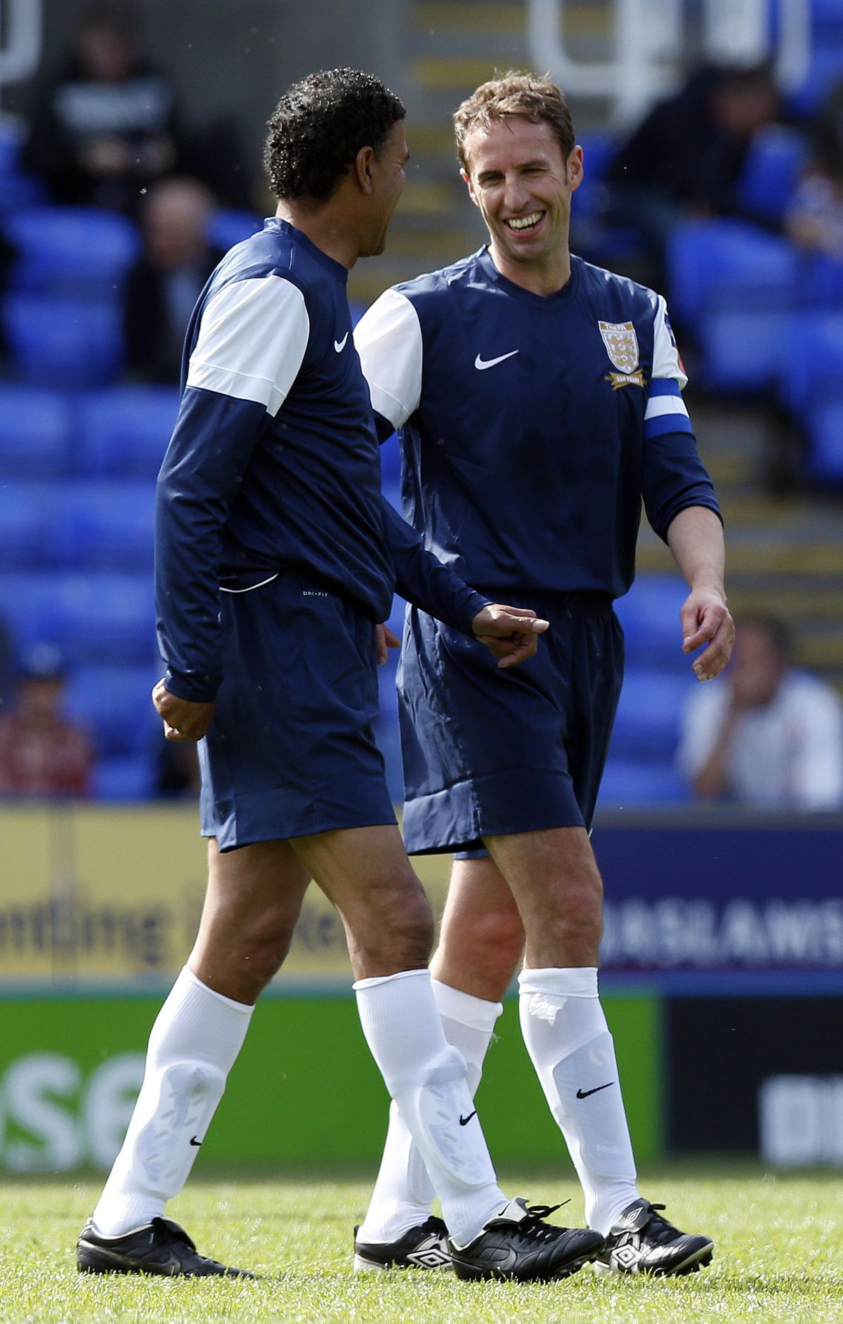 Gareth Southgate (right) and Chris Kamara (left) share a joke during the match between the British Army and FA Legends at the Madejski Stadium, Reading