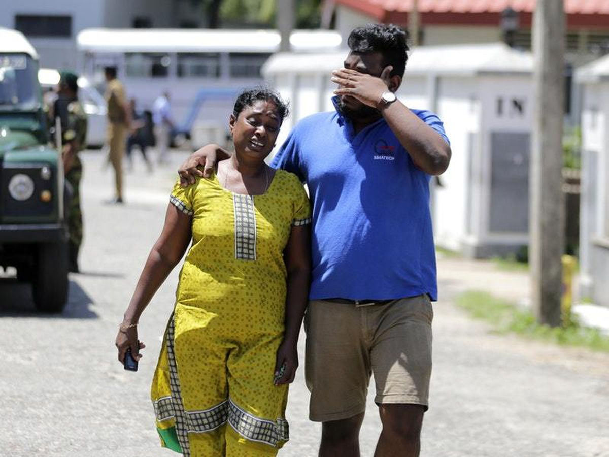 A Sri Lankan couple mourns after identifying a body in Colombo