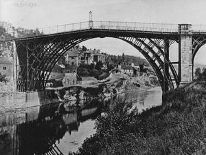 nostalgia pic. Ironbridge. A undated postcard showing the Iron Bridge over the River Severn, and of interest as it shows the gas lamp or gas light which was once at the apex of the bridge. This picture was emailed in by Paul France of Madeley paul-france@sky.com. It is undated but a different postcard picture franked in June 1904 shows the lamp in situ at that date. According to local memories it had disappeared by the 1950s. Paul said: 'Hi Toby, received a couple of parcels containing various photos and books from Liz, the widow of Jeff Wheeldon. The postcard shows the gas lamp above the centre of the bridge... Unfortunately the quality of the pics is not very good but they are interesting.' Ironbridge landscape, panorama, general view. Jeff Wheeldon was a friend of Paul's who lived in the Ironbridge Gorge in the 1960s and 1970s and then moved to Seaton in Devon. Library code: Ironbridge nostalgia 2021..