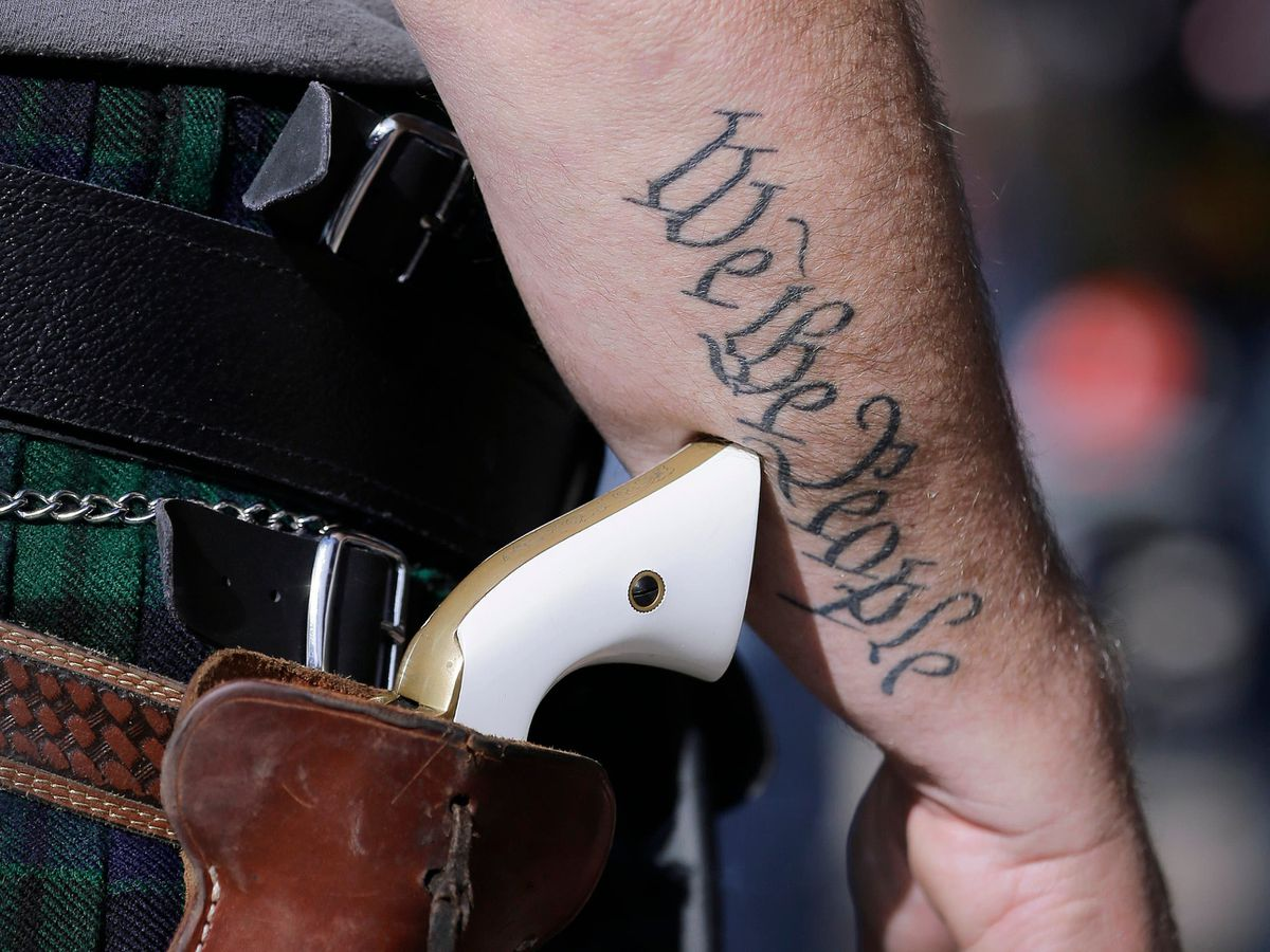 A photo of a handgun on the hip of a supporter of open carry gun laws at a rally in Austin