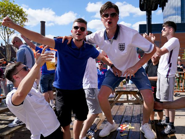 England fans celebrate after watching the Euro 2020 match between England and Croatia