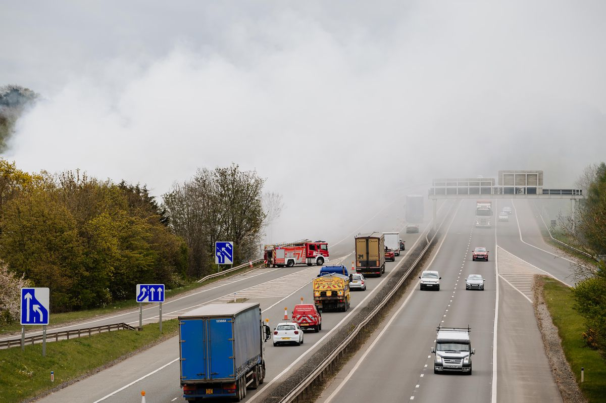 Smoke billows on to the M54 on the morning after the fire
