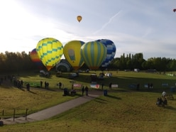 Things are looking up: Hot air balloons take to the skies over Telford for festival weekend