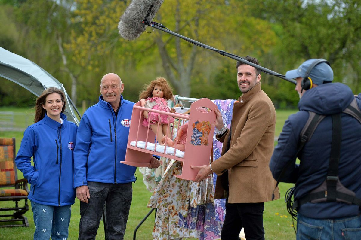 Tim Weeks, chats to Paul and Ruby Burniston from Ewyas Harold, Herefordshire during the Bargain Hunt filming