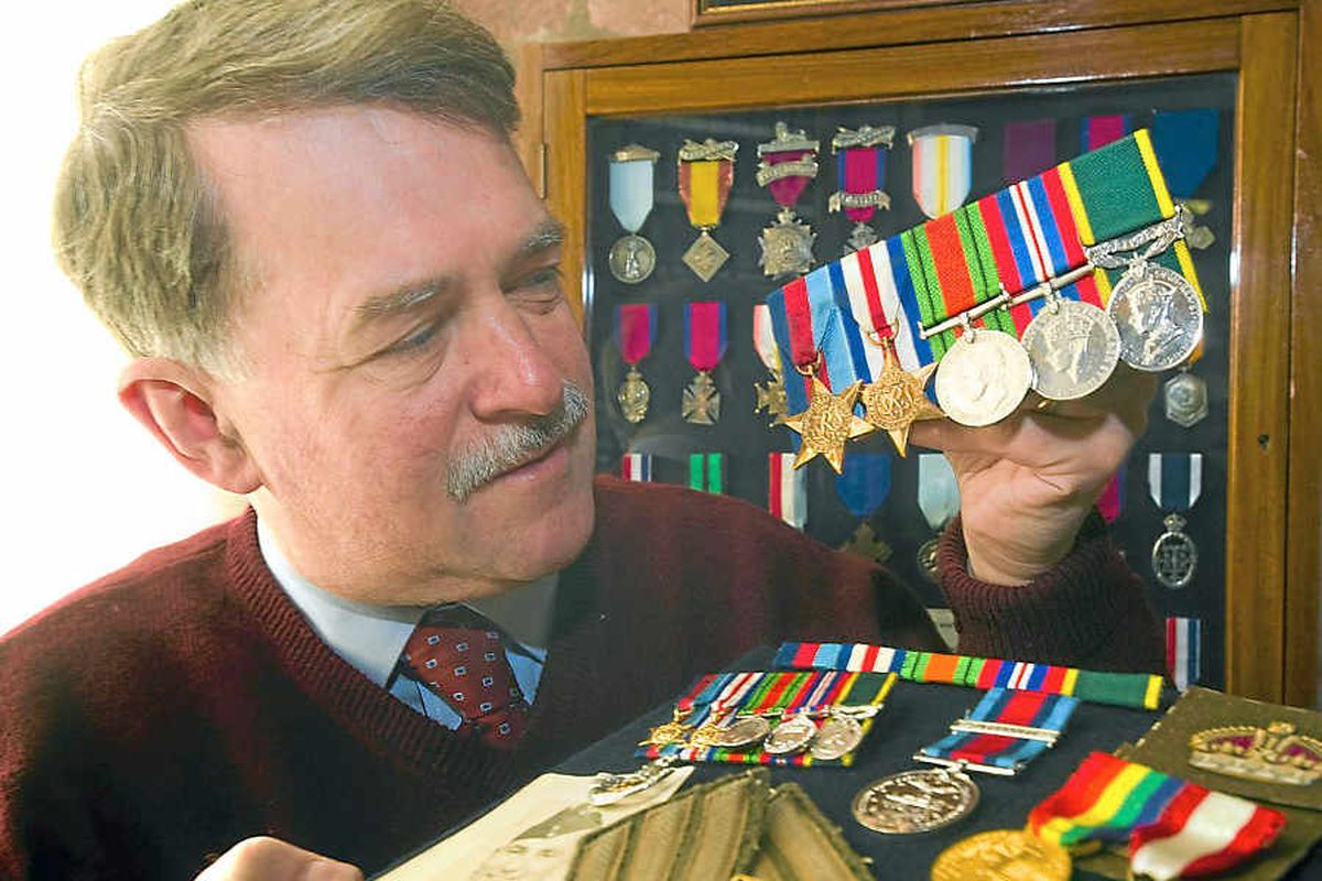 Peter Duckers, curator of Shrewsbury Castle and Regimental Museum, with Harry Langford's medals
