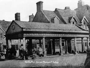 Newport's old Butter Market building, which was demolished in mid-Victorian times, is said to have enclosed the cross. Difficult to tell from this picture, isn't it?