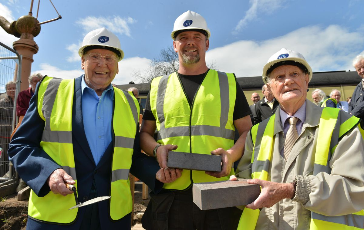 Former railway workers Barry Cook, left and Keith Beddows are joined by Site Manager Darren Cadet as they lay the first bricks for the new building at Bridgnorth Severn Valley Railway Station