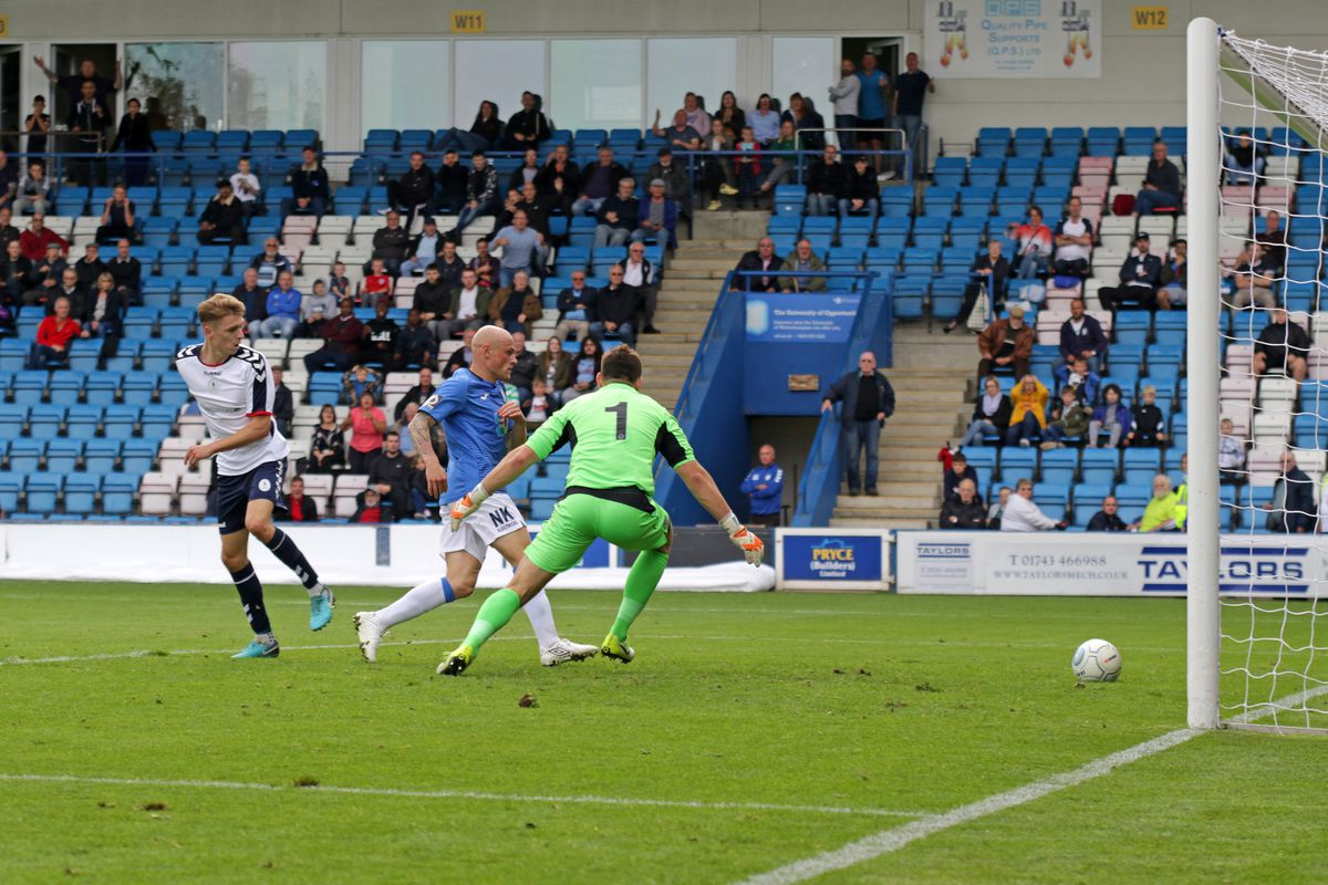 Henry Cowans of AFC Telford scores
