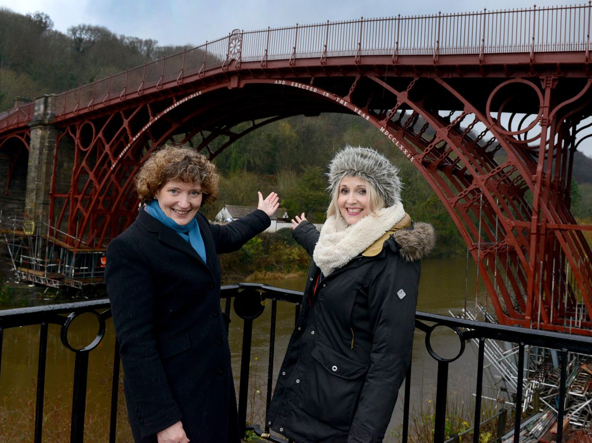 Kate Mavor , chief executive of English Heritage and Nichola Tasker, the organisation's head of national projects, admire the Iron Bridge