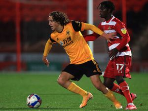 Wolverhampton Wanderers' Fabio Silva (left) and Doncaster Rovers' Taylor Richards battle for the ball during the Papa John's Trophy.