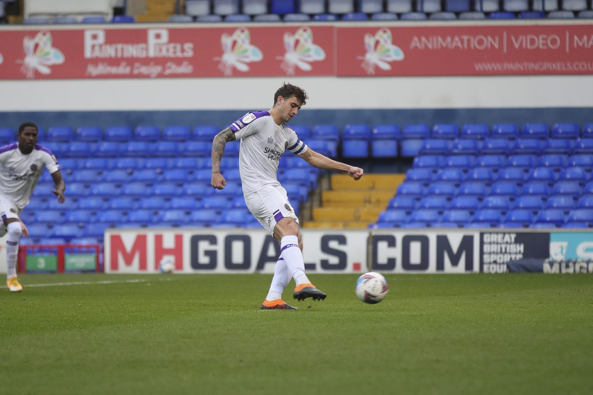 Ollie Norburn of Shrewsbury Town scores a goal to make it 0-1 from the penalty spot (AMA)