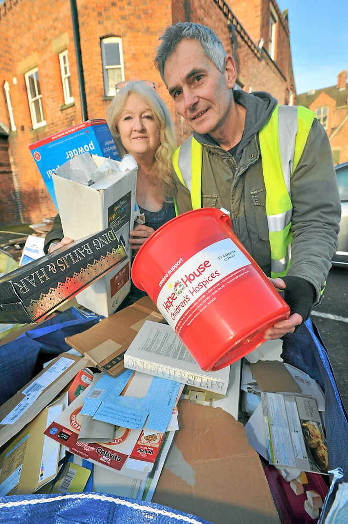 Volunteers Margaret Bowman and Howard Hutchings help recycle cardboard at the United Reformed Church as part of the fundraising effort