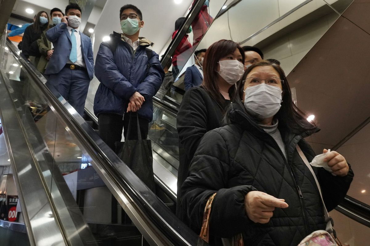 People wear face mask at a shopping mall in Hong Kong
