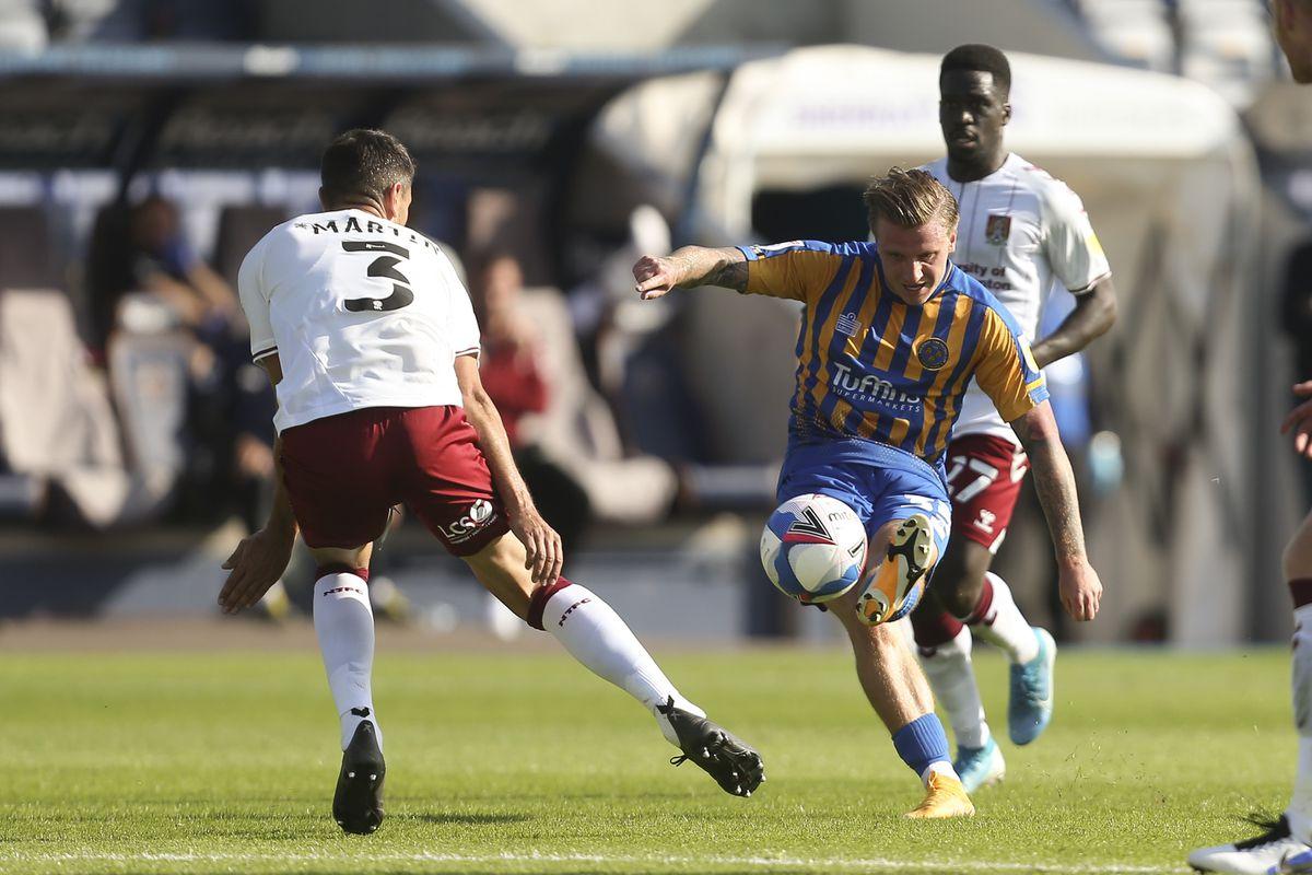 Jason Cummings of Shrewsbury Town shoots at goal. (AMA)