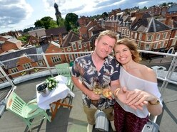 Wedding proposal high on market roof