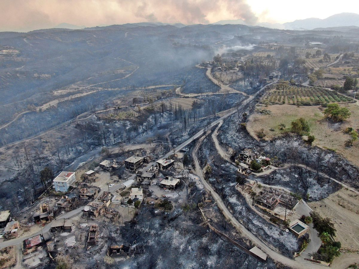 Authorities evacuated homes in southern Turkey as a wildfire fanned by strong winds raged through a forest area near the Mediterranean coastal town of Manavgat (Suat Metin/IHA via AP)