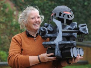 Library assistant Michelle Szulc with her robot creation, the Grim Reader