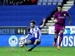 Pitch invasion costs Wigan after Manchester City cup upset