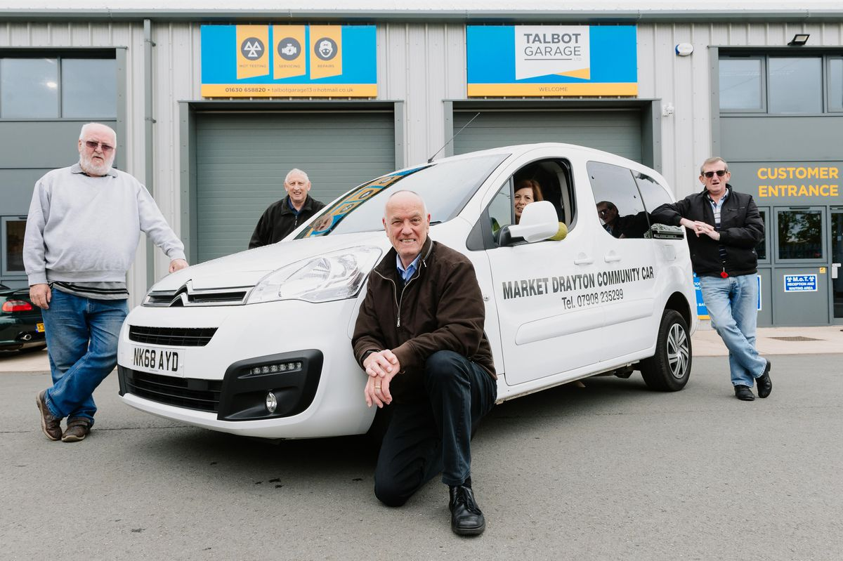The Market Drayton Community Car scheme has a smart new vehicle. From left are: drivers Malcolm Edwards and Colin Barthorpe, trustees Geoff Hurst and Maggie Edwards, and driver Phil Miles