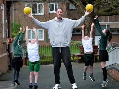Britain's tallest man drops in on Shropshire schoolchildren