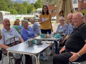 Janna Vigar with visitors at Ludlow's Good Grief Café
