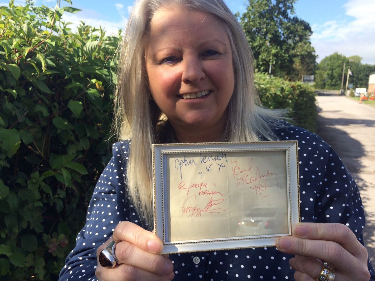 Hansons' music memorabilia specialist Claire Howell with the Beatles signatures