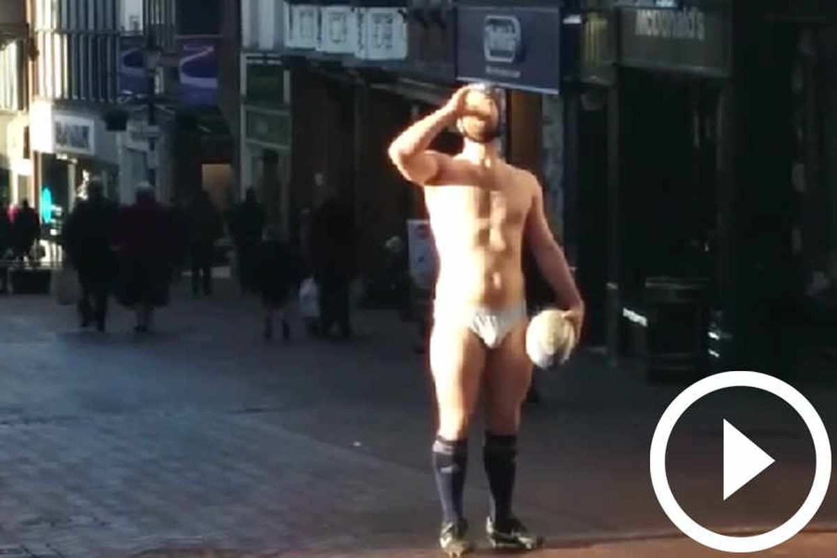 """Andrew Thomas completes his """"neck and nominate"""" challenge - in the centre of Shrewsbury"""