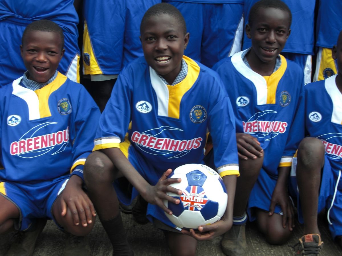 African youngsters donning donated football kits from Shrewsbury Town